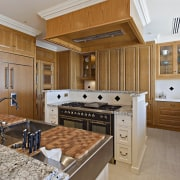 In this new kitchen a custom square hood cabinetry, countertop, cuisine classique, estate, home, interior design, kitchen, real estate, room, brown