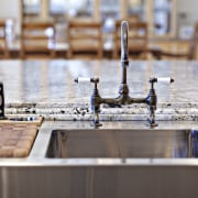 The business end of the main island in countertop, water, wood, gray