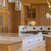 A view of the kitchen. - A view cabinetry, countertop, cuisine classique, home, interior design, kitchen, room, under cabinet lighting, wood stain, brown, orange