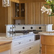 A close up view of the kitchen cabinetry. bathroom, bathroom accessory, bathroom cabinet, cabinetry, countertop, cuisine classique, home, interior design, kitchen, room, sink, wood stain, brown, gray