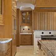 A view of the kitchen. - A view bathroom, cabinetry, countertop, cuisine classique, flooring, home, interior design, kitchen, room, wood, brown, orange