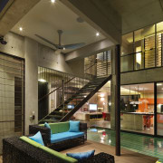 Exposed structural elements give this open-plan house a architecture, billiard room, house, interior design, living room, lobby, real estate, recreation room, brown