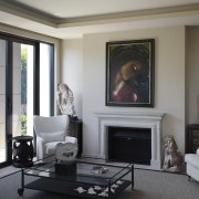 Eclectic interior by owner and designer Garth Barnett furniture, hearth, home, interior design, living room, real estate, room, gray, black