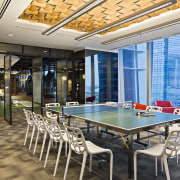 Large pivoting doors can separate the conference room interior design, real estate, table, gray