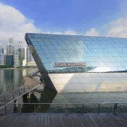 The Louis Vuitton Island Maison in Singapore can architecture, building, corporate headquarters, daytime, headquarters, landmark, metropolitan area, reflection, sky, water, gray, teal