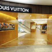 Louis Vuitton Island Maison, Singapore - Louis Vuitton interior design, lobby, orange, brown