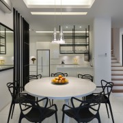 Dining area and kitchen within open-plan interior of dining room, interior design, kitchen, gray