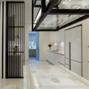 White townhouse kitchen with black contrasting elements, including architecture, interior design, lobby, property, gray