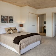 Lockwood show home Tauranga - White painted walls bed frame, bedroom, ceiling, estate, floor, flooring, home, interior design, property, real estate, room, wall, window, wood, gray