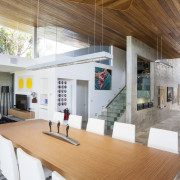 With black glass windows set directly into the architecture, house, interior design, real estate, table, white