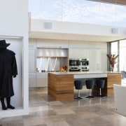 Special niches were designed to accommodate key artworks floor, flooring, furniture, interior design, room, white, gray