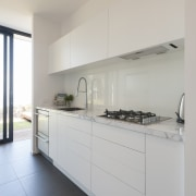 Holistic design by Yellowfox accentuates house and site architecture, cabinetry, countertop, cuisine classique, interior design, kitchen, real estate, room, gray
