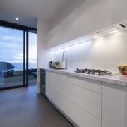 Holistic design by Yellowfox accentuates house and site architecture, countertop, interior design, kitchen, real estate, gray