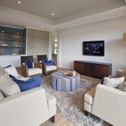 All the laid back charm of the picturesque ceiling, home, interior design, living room, property, real estate, room, gray