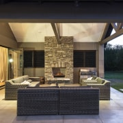 This contemporary, well-balanced masonry home was designed and estate, home, house, interior design, lighting, living room, outdoor structure, patio, property, real estate, black