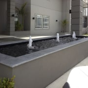 Bringing the restful sight and sound of moving concrete, floor, wall, gray, black
