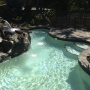 Bringing the restful sight and sound of moving body of water, lagoon, leisure, resort, swimming pool, water, water feature, water resources, watercourse, black, teal
