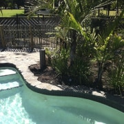 Waterworks Irrigation offers a variety of pool options arecales, backyard, fence, leisure, outdoor structure, palm tree, plant, property, resort, swimming pool, tree, water, water feature, black, teal