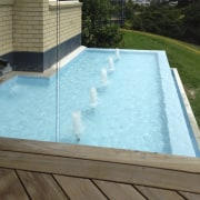 Bringing the restful sight and sound of moving backyard, daylighting, floor, house, leisure, property, real estate, swimming pool, water, water feature, brown