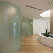 Frameless curved glass walls and doors are a architecture, ceiling, floor, flooring, glass, interior design, real estate, brown