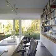 The study in this remodelled house is open architecture, home, house, interior design, real estate, window, gray