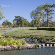 James Hardie Building Products used on House Karaka bank, estate, grass, landscape, landscaping, plant, pond, real estate, reflection, sky, tree, water, waterway, wetland, teal