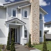 Landmark Homes show home at Karaka Lakes - building, cottage, elevation, estate, facade, home, house, neighbourhood, property, real estate, residential area, roof, siding, suburb, window, gray