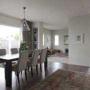 Landmark Homes show home at Karaka Lakes - dining room, floor, flooring, house, interior design, living room, property, real estate, room, table, window, gray, white