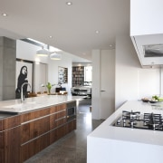 This contemporary kitchen by architect-owner Taras Wolf features architecture, countertop, cuisine classique, interior design, interior designer, kitchen, real estate, gray, white