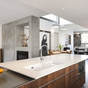 The Caesarstone peninsula benchtop in this modern kitchen cabinetry, countertop, cuisine classique, interior design, kitchen, real estate, room, gray