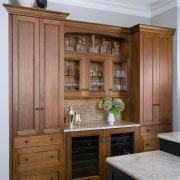 Avid entertainers, the owners of this remodeled kitchen cabinetry, chest of drawers, countertop, cuisine classique, furniture, interior design, kitchen, wood, wood stain, brown, gray