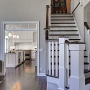 New wide openings were created between the kitchen floor, flooring, furniture, hardwood, home, interior design, stairs, wood, wood flooring, gray