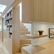 Sandstone terrace renovation by TKD Architects - Sandstone architecture, bookcase, cabinetry, floor, furniture, hardwood, interior design, plywood, product design, shelf, shelving, stairs, wall, wood, gray, brown, orange