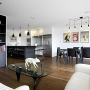 The island in this open-plan family living area apartment, interior design, living room, room, white