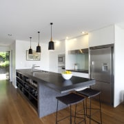 1970s townhouse makeover by  architect-designer  Evelyn architecture, countertop, floor, flooring, furniture, hardwood, house, interior design, kitchen, laminate flooring, real estate, table, wood flooring, white, brown