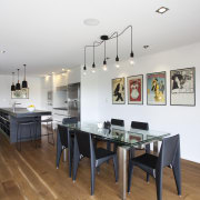 This renovated 1970s townhouse by architect-designer Evelyn McNamara dining room, floor, interior design, real estate, room, table, white