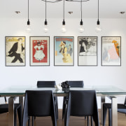 Pendant lights are hung on the same axis, chair, dining room, exhibition, furniture, interior design, light fixture, product design, table, wall, white