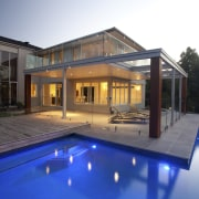 The orientation of this existing house was changed architecture, estate, facade, home, house, lighting, property, real estate, swimming pool, villa, window