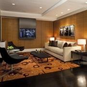 Contemporary apartment interiors dont have to be crisp, ceiling, floor, flooring, furniture, interior design, living room, room, wall, wood flooring, brown, black