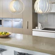 Designer Carolyn Cavanough of Desire Beauty specified a countertop, interior design, kitchen, product design, sink, tap, gray, white