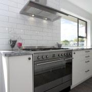 The owners chose a Smeg SUK92MX8 90cm range cabinetry, countertop, cuisine classique, floor, home appliance, interior design, kitchen, kitchen appliance, kitchen stove, major appliance, gray, white