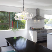The owners chose a Smeg SUK92MX8 90cm range countertop, home, house, interior design, kitchen, room, table, gray