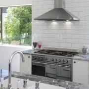 The owners chose a Smeg SUK92MX8 90cm range countertop, cuisine classique, home appliance, interior design, kitchen, kitchen appliance, kitchen stove, tile, gray