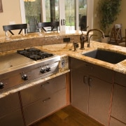 A large scullery boosts utility in this Richard cabinetry, countertop, cuisine classique, flooring, kitchen, room, sink, brown