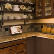 The generous scullery countertops in this traditional kitchen cabinetry, countertop, cuisine classique, furniture, hardwood, interior design, kitchen, kitchen organizer, room, shelf, table, under cabinet lighting, wood, wood stain, brown
