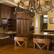 A large scullery boosts utility in this Richard cabinetry, countertop, cuisine classique, dining room, flooring, hardwood, interior design, kitchen, room, brown