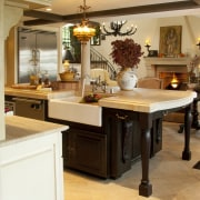 A traditional hearth adds an element of warmth cabinetry, countertop, cuisine classique, furniture, interior design, kitchen, room, table, orange, brown