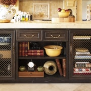 The island in this French kitchen features decorative cabinetry, furniture, black