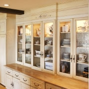 Cabinets in this traditional Provencal-style kitchen has a cabinetry, display case, furniture, interior design, kitchen, orange, white
