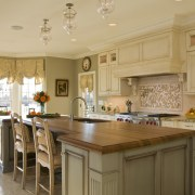 To give this kitchen a traditional European feel, cabinetry, countertop, cuisine classique, estate, home, interior design, kitchen, real estate, room, orange, brown